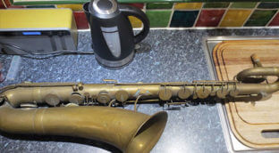 a saxophone on the kitchen counter