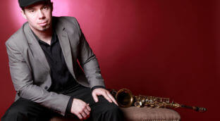 Brian McCarthy with his saxophone