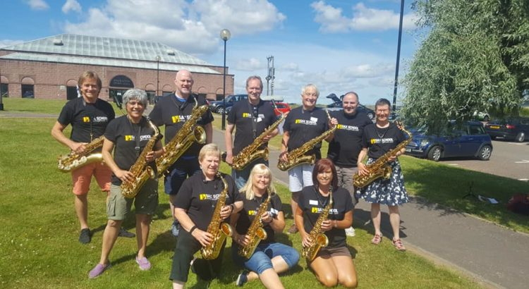 Group photo of Sax School students holding their sax