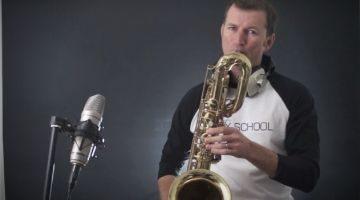 Nigel McGill playing his saxophone