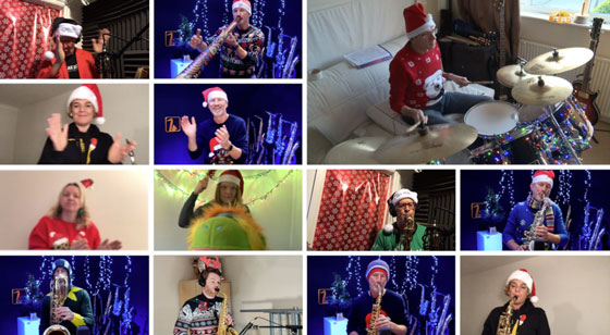 musicians playing their instruments wearing Christmas outfits